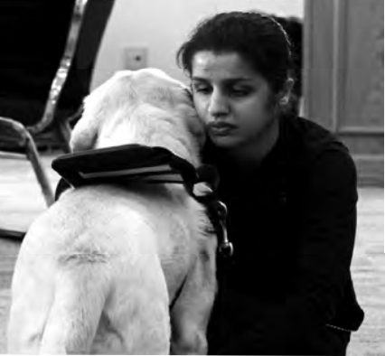 Soma Ali and guide dog Mimi.